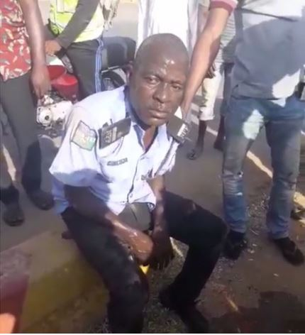 Check Out! People Seize Gun From A Drunk Policeman, Pour Water On Him To Help Him Revive (Video)